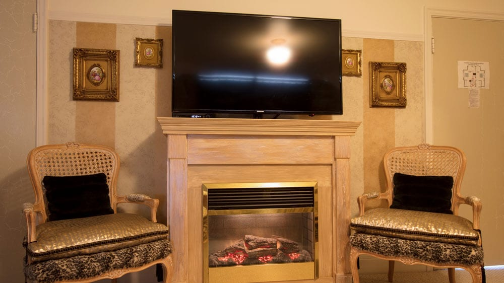 tv and fireplace in luxury suite