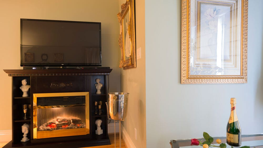 fireplace and tv in vivaldi suite